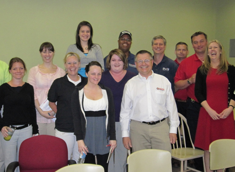 The hard-working employees at Moncrief Heating & Air in Atlanta, GA pose with Steve Coscia after his training session.