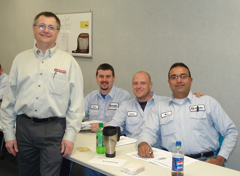 Technicians at Howell's Heating and Air in Ashland, VA pose with Steve after a customer service workshop. Great smiles!